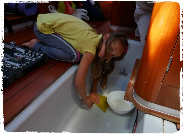 Hard work on the boat to clean fresh water from leaking pipe